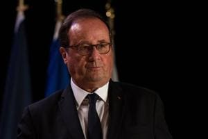 Former French president François Hollande addresses a conference in Montreal.