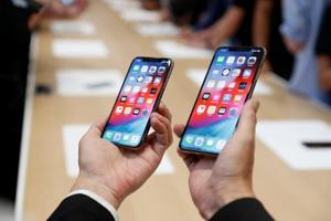 A man holds the newly released Apple iPhone XS and XS Max during a product demonstration following the Apple launch event at the Steve Jobs Theater in Cupertino, California, U.S. September 12, 2018.