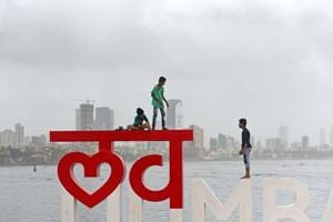 "Children climb on ""I LOVE MUMBAI"" installation at Bandra Reclamation."