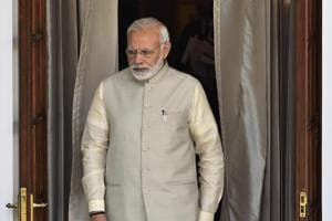 Prime Minister Narendra Modi walks out before a meeting at Hyderabad House, in New Delhi.