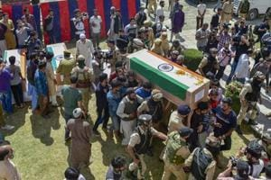 Police officers and relatives shoulder the coffin of the slain police constable Nissar Ahmad Dhobi after a wreath laying ceremony in Shopian on September 21.