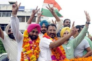 Congress candidates celebrate their win in zila parishad polls in Patiala on Saturday.