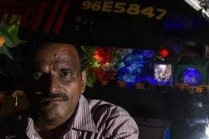 Satyavaan Geete has installed the Ganpati idol inside his auto. He does not take passengers during Ganeshotsav.