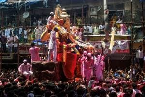 Devotees carry the idol of