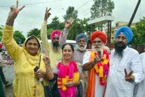 Congress candidate Rajbir Kaur from Attari constituency with her supporters after victory in panchayat polls in Amritsar on Saturday.