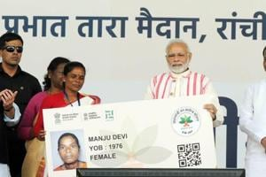Prime Minister Narendra Modi gives a health card to beneficiaries as he launches Ayushman Bharat-National Health Protection Scheme, at Prabhat Tara Ground, at Dhurwa, in Ranchi, on Sunday, September 23, 2018.