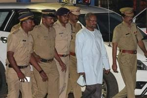 Bishop Franco Mulakkal (second right), accused of raping a nun, is escorted by police outside a crime branch office on the outskirts of Kochi in Kerala.