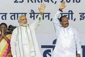 Prime Minister Narendra Modi with and Jharkhand chief minister Raghubar Das wave at their supporters during the launch of Ayushman Bharat-National Health Protection Mission (AB-NHPM) , in Ranchi.