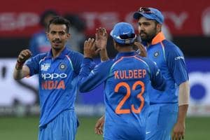 Indian cricketer Yuzvendra Chahal (C) celebrates with teammates after he dismissed Pakistan batsman Asif Ali during the one day international (ODI) Asia Cup cricket match between Pakistan and India