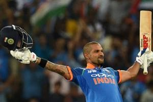 Indian batsman Shikhar Dhawan celebrates after scoring a century (100 runs) during the one day international (ODI) Asia Cup cricket match between Pakistan and India at the Dubai International Cricket Stadium in Dubai.