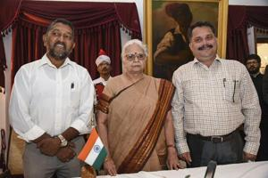 Goa governor Mridula Sinha flanked by newly sworn-in BJP legislators Milind Naik (L) and Nilesh Cabral after they were administered the oath of office in Parrikar-led cabinet, in Panaji on Monday.