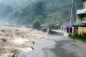 A raging River Beas washes away the Kullu-Manali highway due to incessant rains, on Monday.