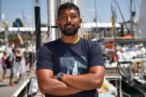 Abhilash Tomy poses on his boat 'Thuriya' in Les Sables d