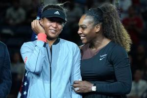 US Open Womens Single champion Naomi Osaka of Japan (L) with Serena Williams of the US during their Women