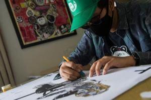 Photos: Spray-can satire creates headache for Thailand junta