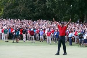 Tiger Woods of the United States celebrates making a par on the 18th green to win the TOUR Championship at East Lake Golf Club on September 23, 2018 in Atlanta, Georgia.