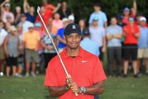 Tiger Woods of the United States poses with the trophy after winning the TOUR Championship at East Lake Golf Club on September 23, 2018 in Atlanta, Georgia.