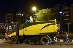PWD worker cleaning Ring road with mechanized vacuum sweepers near Mayur vihar, in East Delhi, India on Friday Night, April 01, 2016.