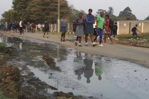 Photos: Raw sewage in Harare's streets brings cholera outbreak to Zimbabwe