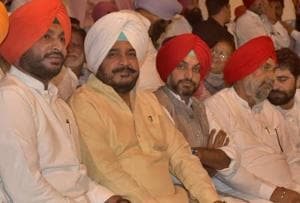 (From left) MP Ravneet Bittu and state minister Sadhu Singh Dharamsot with other Congress leaders during the party's annual conference at Chhapar village in Ludhiana on Monday.