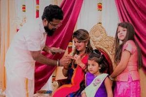 Rambha with husband and daughters at her baby shower.