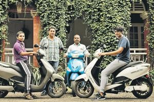(From left to right) Vaibhav Kankhar, Class 10 student; Edward Pereira, owner, Dutch Palace; Edward's manager Ravi Kankhar and Edward's son Nathan Pereira with their electric bikes at Dutch Palace on Monday.