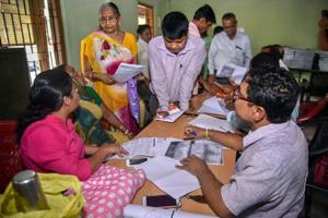 People verify the National Register of Citizens (NRC) forms to file claims and objections at an NRC centre, in Guwahati, on Tuesday.