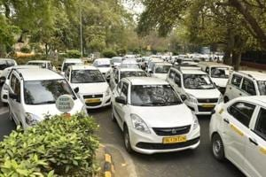 Hundreds of commercial cars parked near Jantar Mantar due to a strike by the drivers of OLA and Uber Cabs at Parliament Street in New Delhi, India, on Thursday, March 22, 2018.