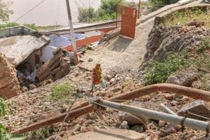 A temple lies in ruins due to landslides followed by heavy rains in Jammu.