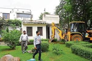 OnTuesday, the government's revenue department demolished at least 60 illegally built structures and sealed three farmhouses that had come up on forest land in south Delhi's Bhati village.