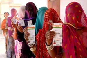 Rajasthani women showing their respective Aadhaar cards while standing in a queue to vote for Ajmer District Panchayat elections.