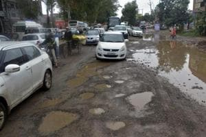 Potholed roads seen at the Delhi-Meerut Road NH58, at Murad Nagar, in Ghaziabad, India, on Tuesday, September 25, 2018.