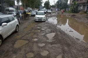 Potholed roads seen at the Delhi-Meerut Road NH58, at Murad Nagar.