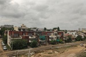 view of abandoned homes in Palam Vihar C Block. Residents have left the area over the last two years due to bad roads and sewage issues, caused by construction of the Bajghera Flyover, in Gurugram, India, on Tuesday, September 25, 2018.