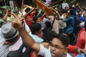 Students activists scuffle with police as they try to go through a barricade during a protest against the state government and the recent killing of two students in North Bengal, in Kolkata on September 25, 2018.