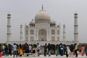Tourists visit the Taj Mahal in Agra. The Archaeological Survey of India (ASI) may impose an extra charge of Rs 200 on tourists visiting the main mausoleum at the Taj Mahal.