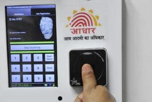 Employees mark their attendance through Aadhaar based system in New Delhi on July 24, 2013.