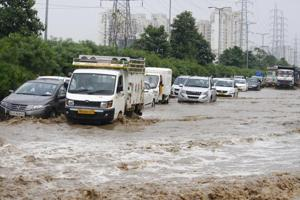 Vehicles wade through a waterlogged street after heavy rains at Golf Course extension road near Emaar building Sector 66, in Gurugram,  Monday, September 24, 2018.  A World Bank study has described India's urbanisation as messy and hidden.