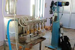 The police seized liquor manufacturing and bottling equipment from the plant.