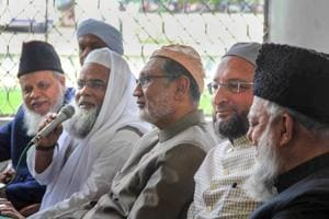 All India Muslim Personal Law Board General Secretary Maulana Khalid Saifullah Rahmani (holding mike), MP Asaduddin Owasis (2nd R) and others address the media on the issue of