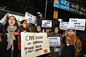 A protest in New Delhi in January 2014: Kaushik Basu suggests that change can come only if the beliefs of citizens and the state converge. In the context of violence against women, patriarchal restrictions on women's mobility are likely to derail justice in cases of sexual assault.