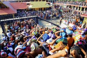 Devotees gather at the Sabarimala Lord Ayyappa Temple, Kerala. There is nothing in the scriptures which decrees that the celibate deity will take umbrage at women in their fertile years entering Sabarimala temple.
