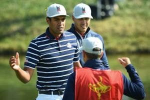 US golfer Brooks Koepka (C) and US golfer Tony Finau (L) celebrate after victory in their fourball match on the first day of the 42nd Ryder Cup at Le Golf National Course at Saint-Quentin-en-Yvelines, south-west of Paris on September 28, 2018.