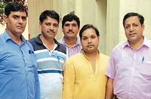 Pulkit Mishra, alias Pulkit Maharaj (in yellow shirt), would allegedly pass himself off as the 'spiritual guru' of Narendra Modi.