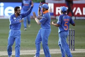 Indian players celebrate the fall of a Bangladesh wicket in the final of the Asia Cup on Friday.