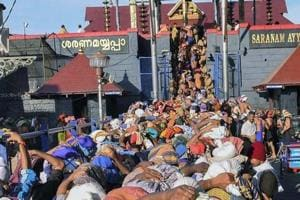 Devotees wait at Lord Ayyappa temple, in Sabarimala. The Supreme Court said women have the constitutional right to enter Sabarimala temple in Kerala.