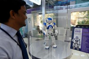 """Bro is a humanoid deployed by Canara Bank, at their digital banking branch in Mumbai, who greets visitors, answers questions and signs off with a warm """"Cheerio!"""""""