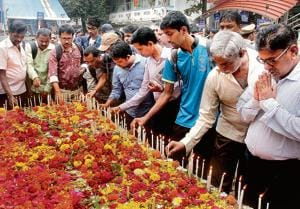 Commuters and relatives pay homage to victims who died in the stampede at Elphinstone Station last year on 29 Sept .