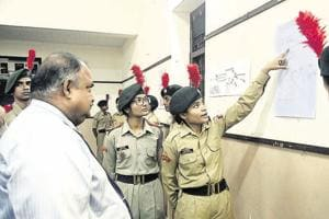 NCC cadets explaining the charts on the surgical strikes at an exhibition at Fergusson college on Saturday.