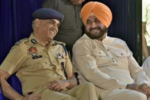 Local bodies minister Navjot Singh Sidhu along with state DGP Suresh Arora during a function in Ludhiana.